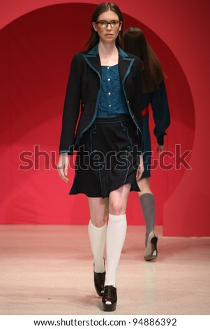 NEW YORK - FEBRUARY 9: Model walks the runway at the Douglas Hannant PINK FW 2012 Collection presentation during Mercedes-Benz Fashion Week on February 9, 2012 in New York. - stock photo