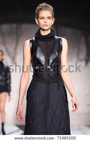 NEW YORK - FEBRUARY 12: Model walks the runway at the G-Star RAW Fall 2011 Collection presentation during Mercedes-Benz Fashion Week on February 12, 2011 in New York.