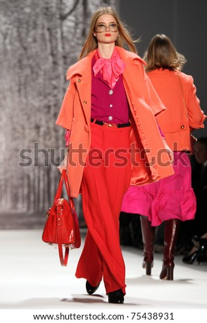 NEW YORK - FEBRUARY 16: Model walks the runway at the Milly by Michelle Smith Fall 2011 collection presentation during Mercedes-Benz Fashion Week on February 16, 2011 in New York. - stock photo