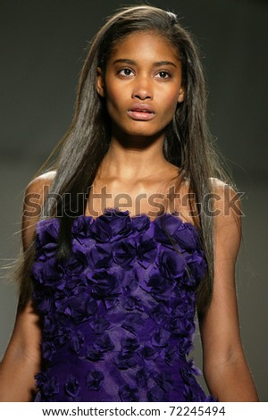 NEW YORK - FEBRUARY 10: Model walks the runway at the Tadashi Shoji Fall 2011 Collection presentation during Mercedes-Benz Fashion Week on February 14, 2011 in New York. - stock photo