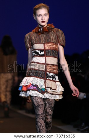"NEW YORK - FEBRUARY 13: Model walks the wooden runway at the Custo Barcelona Fall 2011 ""Clean"" Collection presentation during Mercedes-Benz Fashion Week on February 13, 2011 in New York. - stock photo"