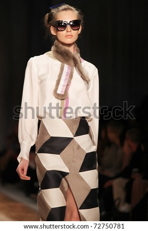 NEW YORK - FEBRUARY 11: Model walks the wooden runway at the Cynthia Rowley Fall 2011 Collection presentation during Mercedes-Benz Fashion Week on February 11, 2011 in New York. - stock photo