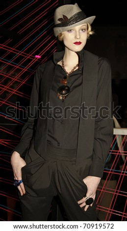 NEW YORK - FEBRUARY 10: Model with blouse by Paola Hernandez, tuxedo pant by Mara Hoffman at W Hotels Glam Presentation in the Mercedes-Benz Fall/Winter 2011 Fashion Week on February 10, 2011 in New York City.
