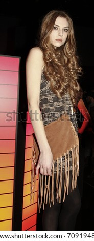 NEW YORK - FEBRUARY 10: Model with dress by Myne and clutch by Posse at W Hotels Glam Presentation in the Mercedes-Benz Fall/Winter 2011 Fashion Week on February 10, 2011 in New York City.