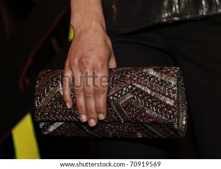 NEW YORK - FEBRUARY 10: Model with embelished clutch by Deepa Gumani at W Hotels Glam Presentation in the Mercedes-Benz Fall/Winter 2011 Fashion Week on February 10, 2011 in New York City.