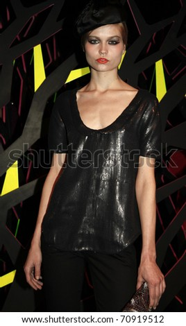 NEW YORK - FEBRUARY 10: Model with top by Twinkle by Wenlan and beret by Eugenia Kim at W Hotels Glam Presentation in the Mercedes-Benz Fall/Winter 2011 Fashion Week on February 10, 2011 in New York City.