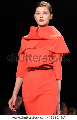 NEW YORK - FEBRUARY 14: Model Yulia Kharlaponova walks the runway at the Carolina Herrera Fall 2011 Collection presentation during Mercedes-Benz Fashion Week on February 14, 2011 in New York. - stock photo