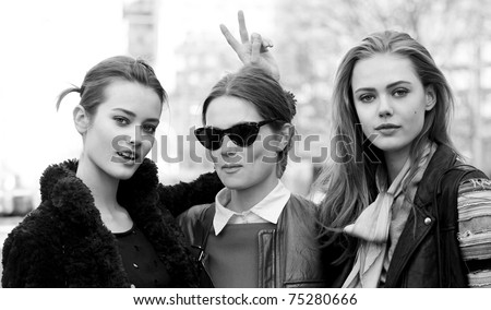 NEW YORK - FEBRUARY 16: Models Jac Jagaciak, Caroline Brasch Nielsen, Frida Gustavsson after Michael Kors Fall 2011 collection presentation  during Mercedes-Benz Fashion Week on February 16, 2011 - stock photo