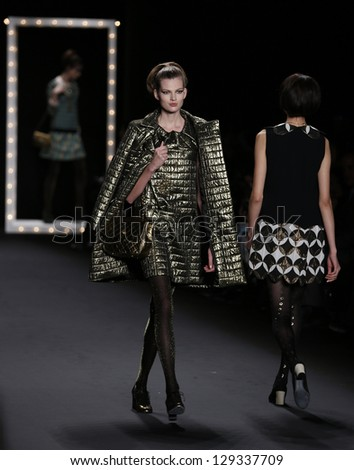NEW YORK - FEBRUARY 13: Models walk runway during Fall/Winter 2013 presentation for Anna Sui collection at Mercedes-Benz Fashion Week at Lincoln Center on February 13, 2013 in New York - stock photo