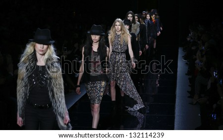 NEW YORK - FEBRUARY 08: Models walk runway for collection by Nicole Miller during Fall/Winter 2013 at Mercedes-Benz Fashion Week at Lincoln Center on February 8, 2013 in New York - stock photo