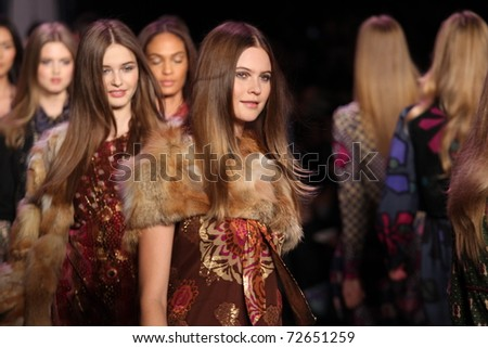 NEW YORK - FEBRUARY 16: Models walk the runway at the Anna Sui Fall 2011 Collection during Mercedes-Benz Fashion Week on February 16, 2011 in New York.