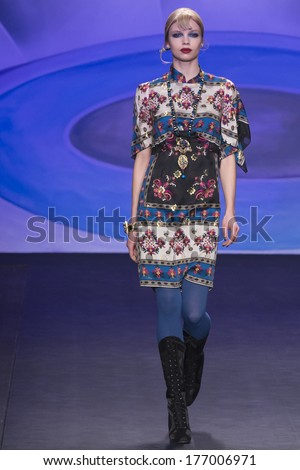 NEW YORK - FEBRUARY 12 2014: Morgane Warnier walks the runway during Anna Sui Fall 2014 fashion show at New York Mercedes - Benz Fashion Week - stock photo
