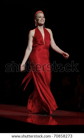 NEW YORK - FEBRUARY 09: Natasha Bedingfield in Nicole Miller dress walks runway for The Heart Truth's Red Dress Collection at Mercedes-Benz Fall/Winter 2011 Fashion Week on February 09, 2011 in NYC