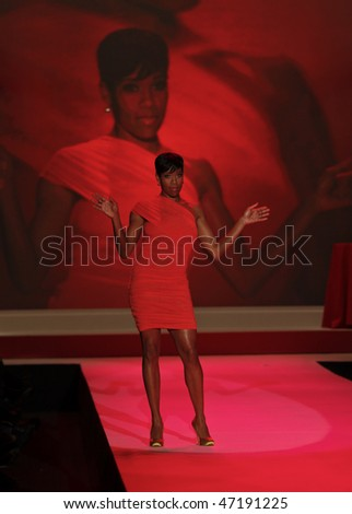 NEW YORK - FEBRUARY 11: Regina King walks the runway at the Heart Truth's Red Dress Collection for Fall/Winter 2010 during Mercedes-Benz Fashion Week on February 11, 2010 in New York