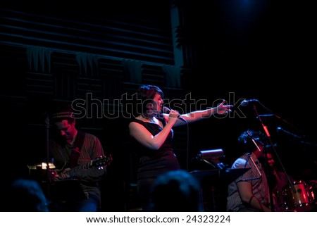 NEW YORK - FEBRUARY 2: Singer Kate McGarry gestures as she performs at Joe's Pub on February 2, 2009 in New York City. McGarry has been nominated for a Grammy.