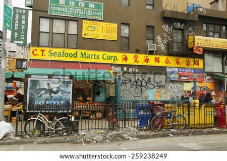 NEW YORK - FEBRUARY 26, 2015: Street scene in Chinatown in New York. Chinatown, Manhattan is a neighborhood in Manhattan that is home to the largest enclave of Chinese people in the Western Hemisphere - stock photo