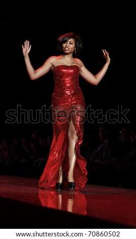 NEW YORK - FEBRUARY 09: Taraji Henson in Naeem Khan dress walks runway for The Heart Truth's Red Dress Collection at Mercedes-Benz Fall/Winter 2011 Fashion Week on February 09, 2011 in New York City.