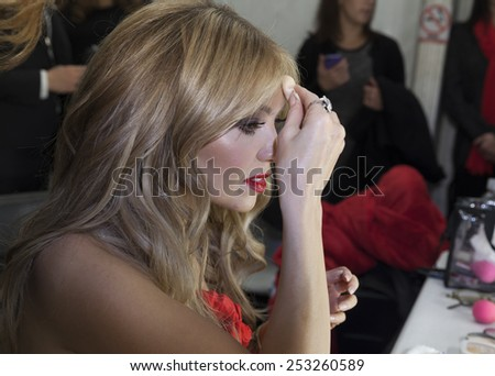 NEW YORK - FEBRUARY 12, 2015: Thalia prepares backstage for the Heart Truth Red Dress Collection 2015 fashion show as part of Fall 2015 Mercedez-Benz Fashion Week at Lincoln Center