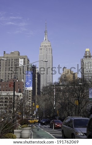 NEW YORK - FEBRUARY 13: The Empire State Building from Broadway outside Madison Square Park.  Photo taken February 13, 2013. - stock photo