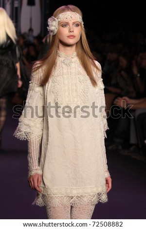 NEW YORK - FEBRUARY 16: Top model Frida Gustavsson walks the runway at the Anna Sui Fall 2011 Collection presentation during Mercedes-Benz Fashion Week on February 16, 2011 in New York. - stock photo