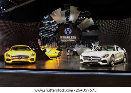 NEW YORK - FEBRUARY 18: Two new 2016 Mercedes-AMG GT S shoving on Fall/Winter 2015 collection during Mercedes-Benz Fashion Week in New York on February 18, 2015. - stock photo