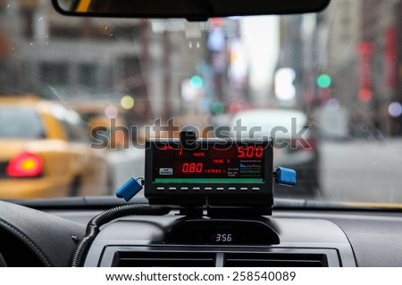 NEW YORK - FEBRUARY 16:  View from cab with meter display in New York on February 16, 2015. - stock photo