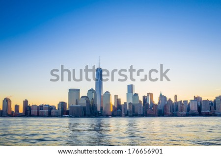 NEW YORK - FEBRUARY 10: View of Manhattan Island from Jersey on February 10, 2014. Manhattan Island is bounded by the Hudson River to the west and the East River to the east.  - stock photo