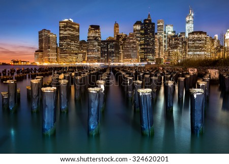 New York Financial District with Freedom Tower still under construction and an old Brooklyn pier - stock photo