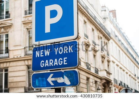 New York Garage parking area in the heart of the city with beautiful luxury buildings in the background - stock photo
