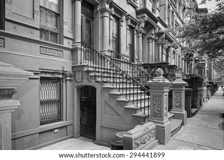 New York houses in Perron in Harlem in black and white - stock photo