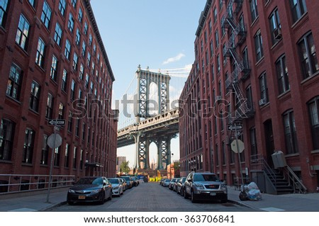 New York: iconic view of Manhattan Bridge from Dumbo neighborhood on September 16, 2014. The Manhattan Bridge, known as the famous landmark, opened to traffic in 1909 and has a main span of 1470 feet - stock photo