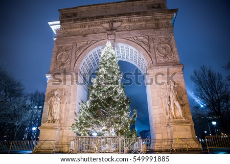 NEW YORK - JAN 3, 2017: bright Christmas tree under arch on Washington Square North at night in NYC. Washington Square Park is a popular public space with an annual holiday tree each December.