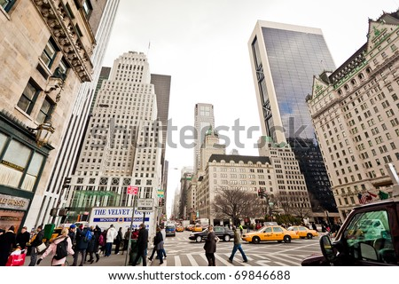 NEW YORK - JAN 6: City streetlife in point of intersection of 5th Av. and 59th st. near  Central Park and Plaza Hotel on January 6, 2011 in Manhattan, New York City - stock photo