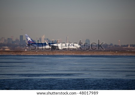 NEW YORK - JANUARY 6: A Boeing 767 passengers plane departs from JFK Airport Runway 4L on January 6, 2010 in New York