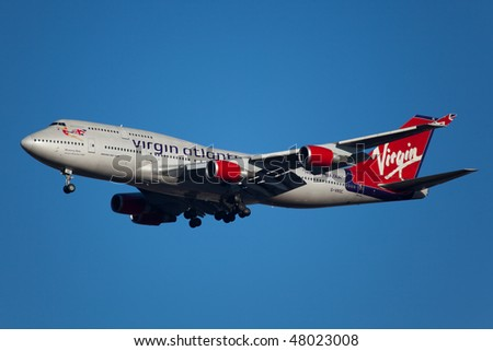 NEW YORK - JANUARY 9: A Boeing 747  Virgin UK lands at JFK Airport on Runaway 4R on January 9, 2010 in New York. Long haul twin jet, wide body - stock photo