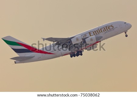 NEW YORK - JANUARY 2: A38 Emirates approaching JFK airport in New York, USA on January 2, 2011. A380 as of 2011 is the biggest commercial airplane and the newest plane built by Airbus company - stock photo