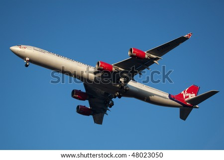 NEW YORK - JANUARY 9: An Airbus A340 Virgin Atlantic Airlines lands at JFK Airport on Runaway 31R on January 9, 2010 in New York. - stock photo
