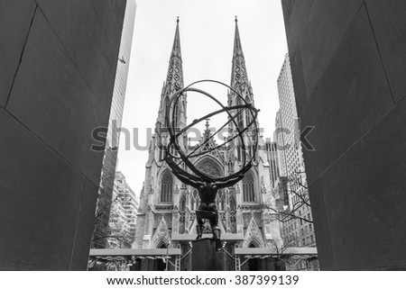 NEW YORK - JANUARY 11: Atlas Statue at Rockefeller Center and a wide view of St. Patricks Cathedral on 5th Ave on January 11, 2009 in midtown Manhattan, New York City. - stock photo