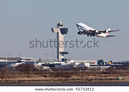 NEW YORK - JANUARY 3: Boeing 747 China Airlines taking off from JFK Airport on January 3, 2012. JFK Airport is one of the biggest and most busy airports in the world with 4 runways and 8 terminals - stock photo