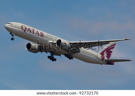 NEW YORK - JANUARY 5: Boeing 777 Qatar on final approach to JFK in New York, USA on JANUARY 5, 2012 Qatar Airline is rated 3rd best airlines in the world Qatar airline is flag carrier airline of Qatar - stock photo