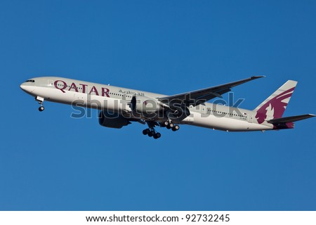 NEW YORK - JANUARY 5: Boeing 777 Qatar on final approach to JFK in New York, USA on JANUARY 5, 2012 Qatar Airline is rated 3rd best airlines in the world Qatar airline is flag carrier airline of Qatar