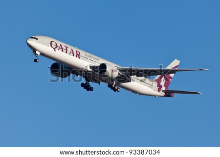 NEW YORK - JANUARY 5:Boeing 777 Qatar on final approach to JFK in New York, USA on JANUARY 5, 2012 Qatar Airline is rated 3rd best airlines in the world Qatar airline is flag carrier airline of Qatar - stock photo