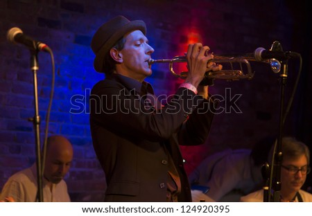 NEW YORK - JANUARY 12: Brian Carpenter harmonica performs with Ghost Train Orchestra on stage as part of NYC Winter Jazz Festival at The Bitter End on January 12, 2013 in New York City - stock photo