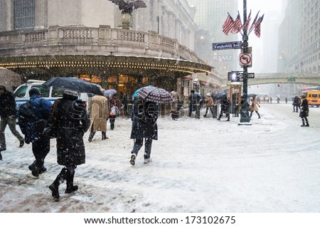 NEW YORK-JANUARY 21: Commuters deal with the snow near Grand Central Terminal during Winter Storm Janus on January 21, 2014 in Manhattan. - stock photo