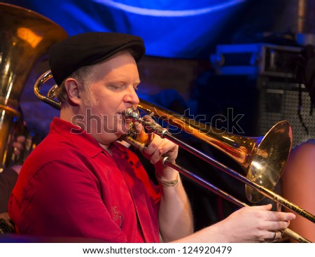 NEW YORK - JANUARY 12: Curtis Hasselbring trombone performs with Ghost Train Orchestra on stage as part of NYC Winter Jazz Festival at The Bitter End on January 12, 2013 in New York City - stock photo