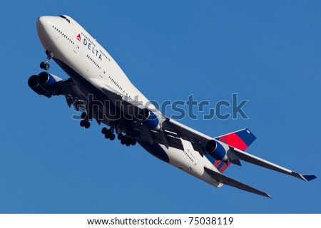 NEW YORK - JANUARY 2: Delta Boeing 747 on approach to JFK in New York, USA on January 2, 2011. Delta Air Lines is one of the major American airline that serves domestic and international destinations - stock photo