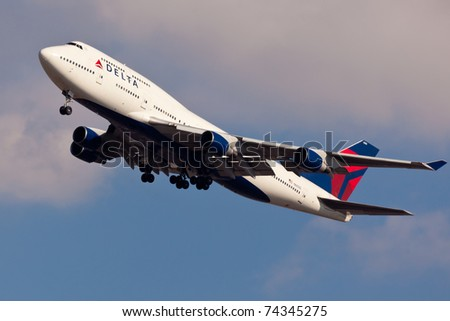 NEW YORK - JANUARY 2: Delta Boeing 747 on final to JFK in New York, USA, on January 2, 2011. Delta Air Lines is of of the major American airlines serve domestic and international destinations - stock photo