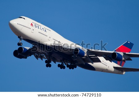NEW YORK - JANUARY 2: Delta Boeing 747 on final to JFK in New York, USA, on January 2, 2011. Delta Air Lines is one of the major American airlines that serves domestic and international destinations - stock photo