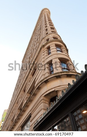 NEW YORK - JANUARY 16 : Flat Iron building facade on January 16, 2011. Completed in 1902, it is considered to be one of the first skyscrapers ever built. - stock photo