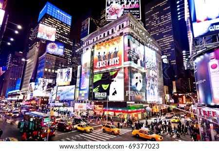 NEW-YORK - JANUARY 6: Illuminated facades of Broadway theaters on January 6, 2011 in Times Square, NYC - stock photo